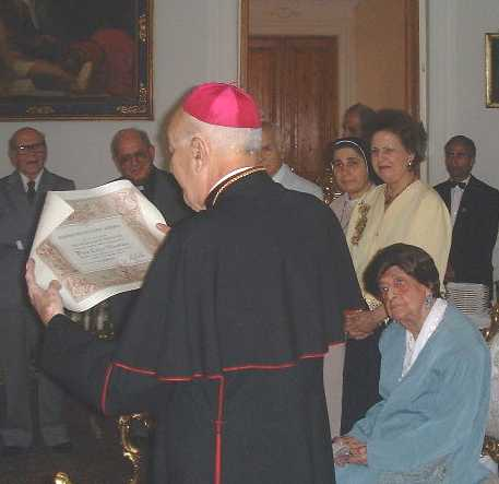 Apostolic Nuncio in Egypt Archbishop Paolo Giglio reading certificate